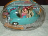 Doll in a Cabriolet Bubble Car, still in sealed display bubble. Brand New