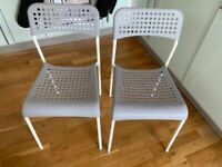2 grey and white chairs for sale