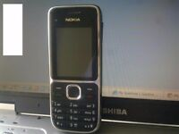 Mobile phone Nokia C2-01 with charger on Orange EE