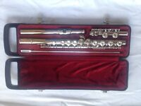 Yamaha flute, stand and books