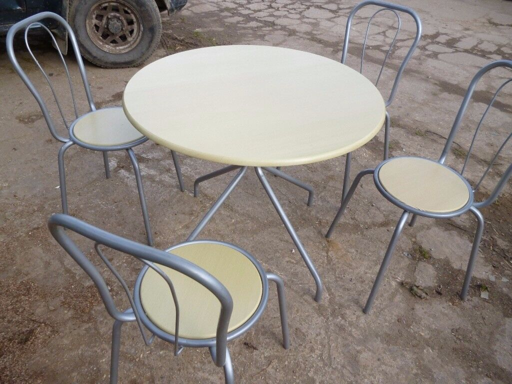 TABLE AND FOUR CHAIRS VGC