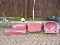coloured bathroom suites one set green and the other set burgandy all in very good condition .