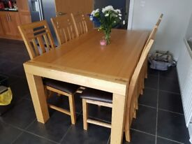 Solid Oak table and 6 dining chairs