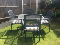Garden table & 4 chairs with cushion pads