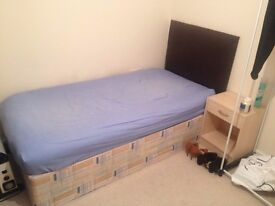 Single bed with headboard, only 18 months old. Cost £150 new