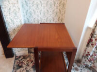 old brown wood drop leaf table with sheve at the bottom