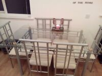 Very sturdy. Glass dining table and 6 chairs. Very good condition. Selling due to moving house.