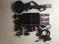 PS3 including Guitar Hero,PS Move & Singstar