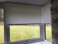 Bay window white roller blinds.Used 3 months