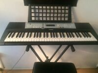 Yamaha keyboard with stand,book stand and stool