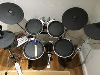 Yamaha DTXtreme electronic Drum Kit on Roland stand + Sennheiser headphones + pair of new sticks.