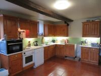 Solid Pine kitchen with Zanussi oven, hob and sink with taps