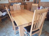 Dining/kitchen table and four chairs. VGC oak with faux leather seats on upright chairs. £250 ono.