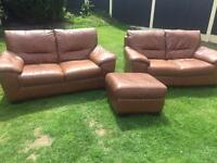 Tan leather 2x2 seater sofas with storage footrest. Can deliver