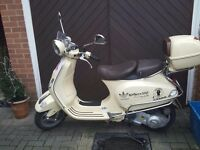 Vespa Cream LXV 125 i.e. with leather seat/box, some damage to foot plate, left pod and box