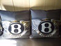 1 Pair of Bentley Emblem Pillows. £30 the pair