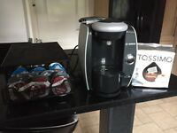 TASSIMO MACHINE WITH COFFEE PODS AND POD HOLDER