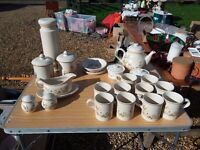 Crockery, mugs, gravy boat and other matching items.