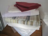 Pile of Single bed linens + Mattress protector
