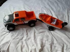 Tonka truck and speedboat