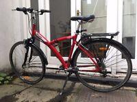 Decathlon Original 5 red hybrid bike, with Schwalbe Maraththon Plus tyres