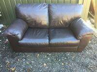 Brown leather sofa. Can deliver.
