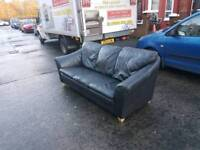 Black leather 3 seater sofa on pine feet