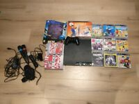 Playstation 3 + Eye Camera, Move Controller, Microphones, Wireless Controller + Games