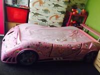 Pink racing car bed