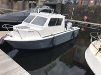 Fishing boat 150hp outboard