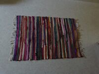 Colourful striped handwoven rag rug