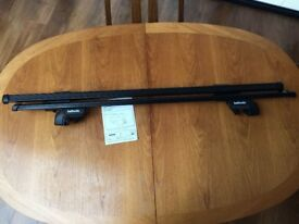 2 Halfords car roof bars E fitting. As new condition, only used once. With instructions.