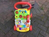 Baby walker as new sings does numbers activity £12 I can deliver if local