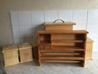 Set of wooden tea, coffee, sugar and bread containers.