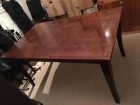 Wooden dining table and six dining chairs
