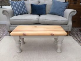 Solid pine coffee table with stripped top and painted base