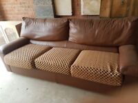 3/4 seater brown leather sofa with fabric seat covers very soft leather..