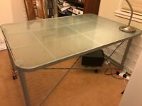 Large glass-topped Ikea desk