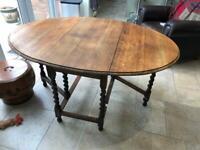 Antique oak - oval drop leaf table