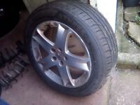 Peugeot alloy wheel with new 215/55zr/17 tyre - can post
