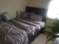 Single bedroom with a double bed and tv