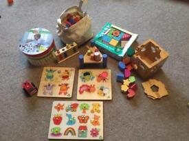 Collection of wooden puzzles and construction
