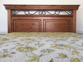 Beautiful solid wooden double bed frame with metal detail