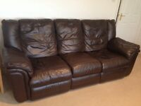 Brown leather suite. 2 & 3 seater manual recliner sofas.