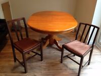Extendable wooden dining table (from 3 to 6 people) and two chairs for sale