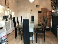 Contemporary Glass Dining Table and 8 black leather chairs
