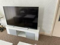 White and grey TV stand with 2 side compartments