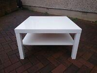 White table, side board, tv unit.