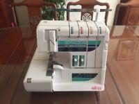 Elna 744 Overlocker Sewing Machine with Accessories.