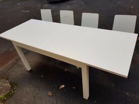 White IKEA extendable dining table and 4 chairs. FREE delivery in Derby